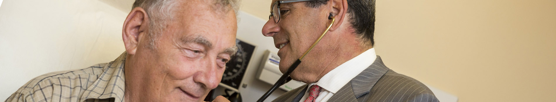 Dr. Koren listens to a patient's heart
