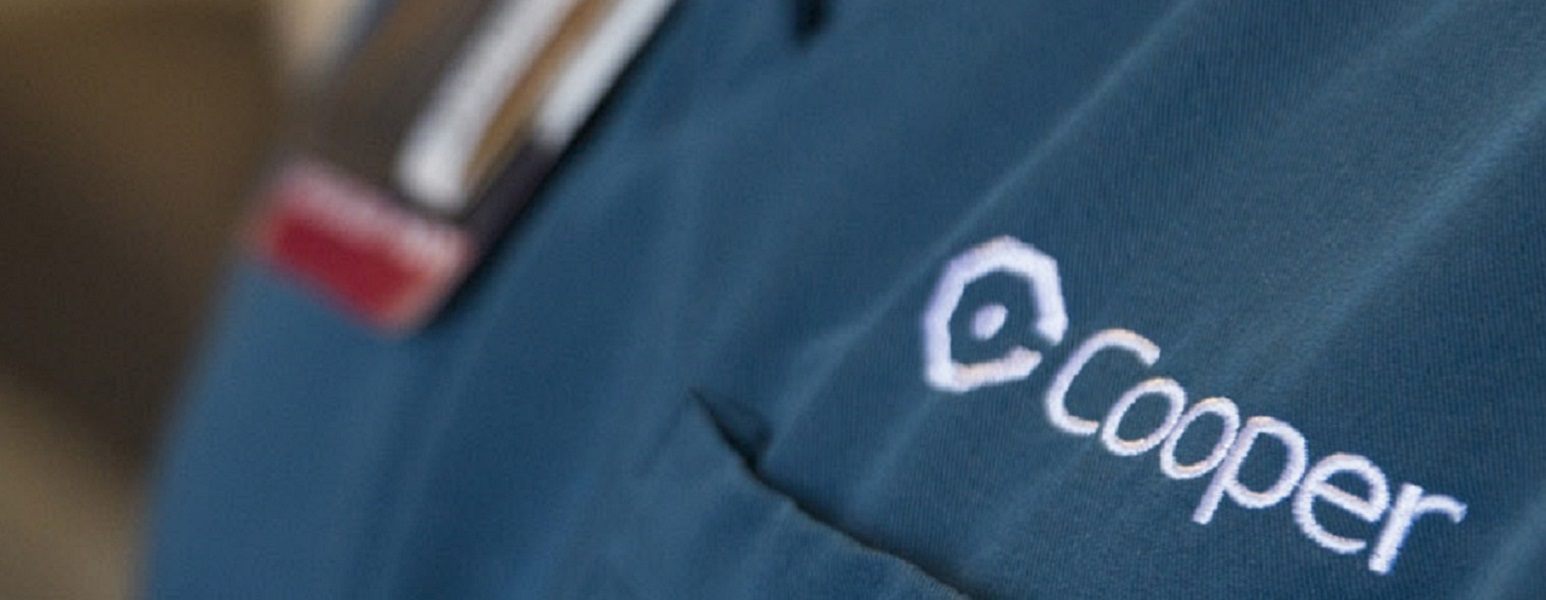 tech with Cooper logo on scrubs